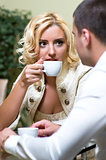 Young couple drinking coffee in a restaurant