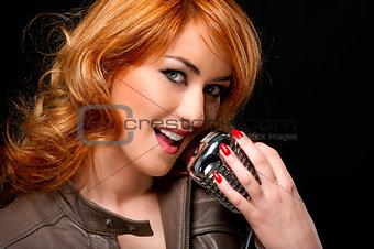 Beautiful redhead woman singing