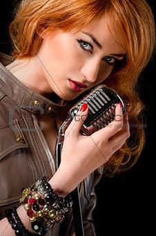 Beautiful redhead girl with microphone