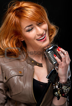 Beautiful redhead young woman singing