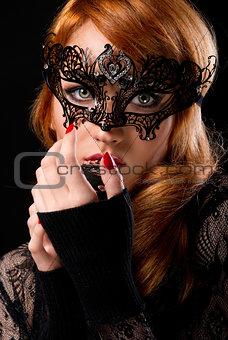 Beautiful redhead woman with retro microphone
