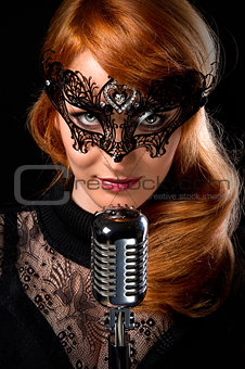 Gorgeous redhead woman with retro microphone