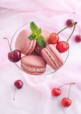 Pink french macarons with cherry