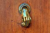 Hand shaped door knob.