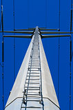 Looking up ladder on electrical tower
