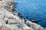 Sloped breakwall by water
