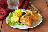 baked chicken leg with corn for garnish