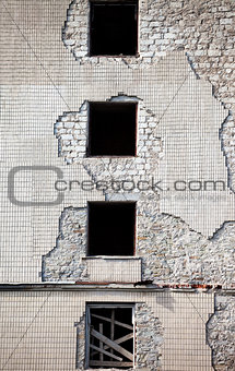 Brick wall of old destroyed house