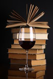 Wine glass and books