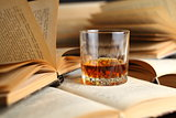 Glass of whiskey on books