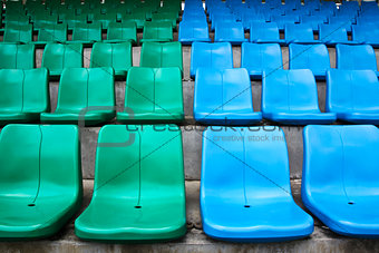 Green and blue stadium seats.