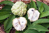 Custard apple with leaves in wicker basket