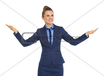 Business woman showing something big