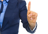 Closeup on business woman showing 1 finger