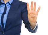 Closeup on business woman showing 4 fingers