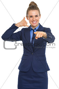Business woman calling with hand gesture and pointing in camera