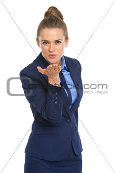 Portrait of happy business woman blowing kiss