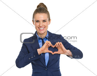 Portrait of happy business woman showing heart with fingers