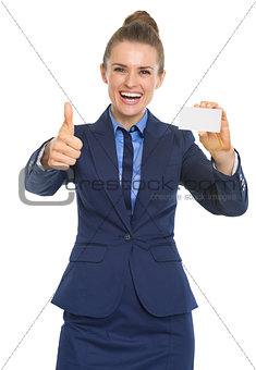 Portrait of smiling business woman showing business card and thu