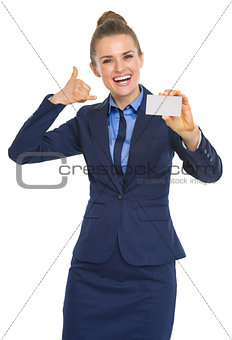 Portrait of smiling business woman showing business card and cal