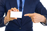 Closeup on business woman pointing on business card