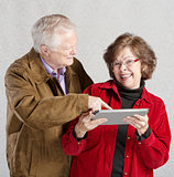 Man Looking at Woman's Tablet