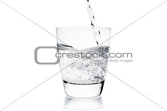 pouring a glass with pure water with bubbles