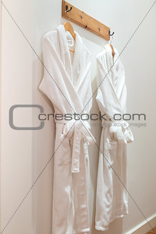 Bathrobes hanging on the wall
