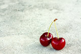 Two Cherries On Gray Background