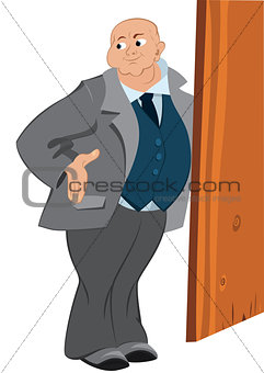 Retro hipster bold man standing near the door