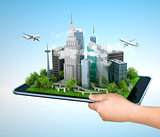 Image of hand holding tablet with illustration of city, 3d