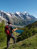 Hiker admiring mountain landscape in Val Veny, Mont Blanc