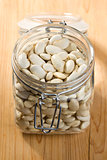 white beans in glass jar