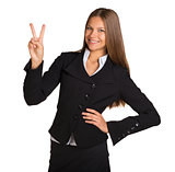 Businesswoman showing victory sign