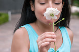 Woman Smelling White Rose