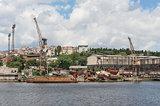 Derelict dockyard by river in city
