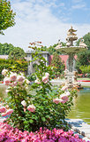 Ornate swan styled fountain in formal garden