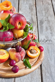 Apricots, nectarines and saturn peaches background