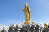 Buddha standing on a mountain