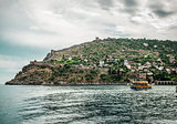 Beautiful landscape with sea, ship and Alanya Castle. Turkey