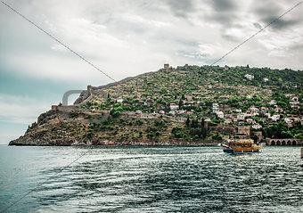 Beautiful landscape with sea, ship and Alanya Castle. Turkey