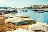 Old boats on the empty beach of Ibiza.  Balearic Islands, Spain