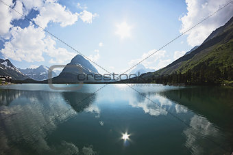Bright sky reflects off lake.