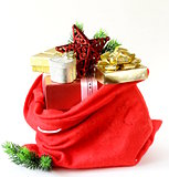 red bag full of Christmas gifts, boxes and decorations