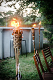 Burning tiki torch in the backyard
