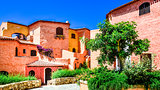 Beautiful colorful houses with nice garden in Sardinia