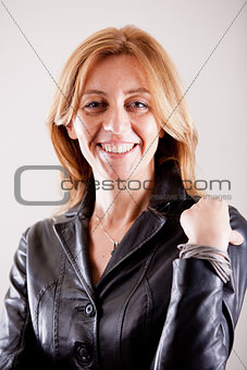 Blonde real woman smiling in black leather jacket