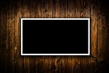 Blank black Poster hanging on wooden wall