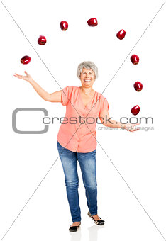 Old woman throwing apples