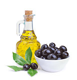 olive oil and black olives with leaves